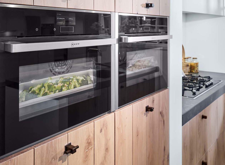 Modern landelijk keukeneiland in houtkleur bekijk foto 39 s for Neff apparatuur